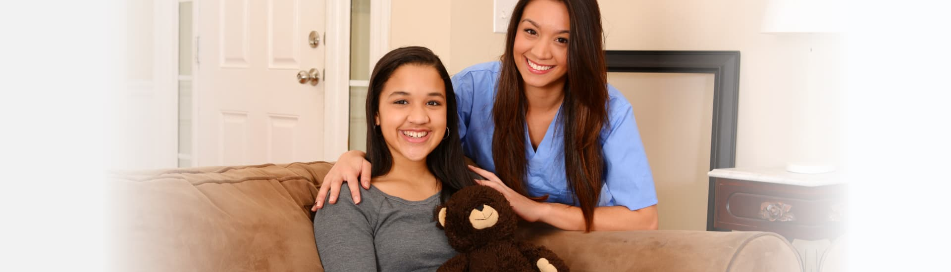 caregiver and a woman smiling